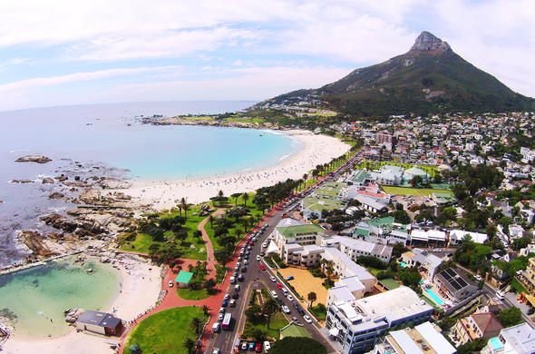 Stunning aerial views of Lions Head and Camps Bay beach.