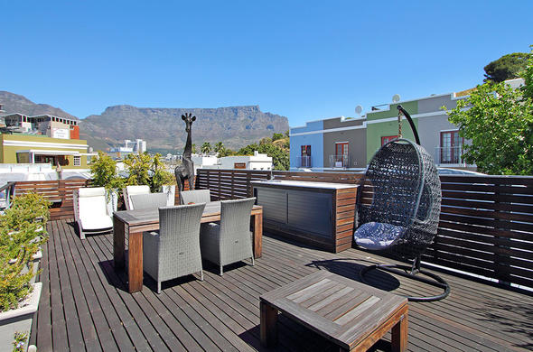 Enjoy views of Table Mountain from the De Waterkant Village deck.