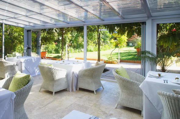 Dining area with stunning views and access to the garden.