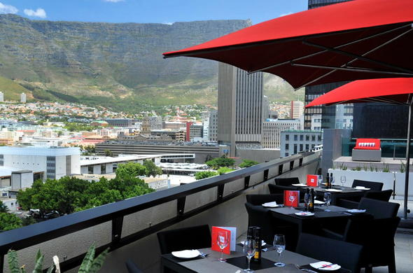 Dining on the Park Inn by Radisson Cape Town Foreshore rooftop with stunning views.