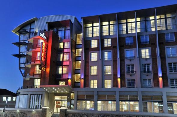 Exterior view of Protea Hotel Victoria Junction by night.