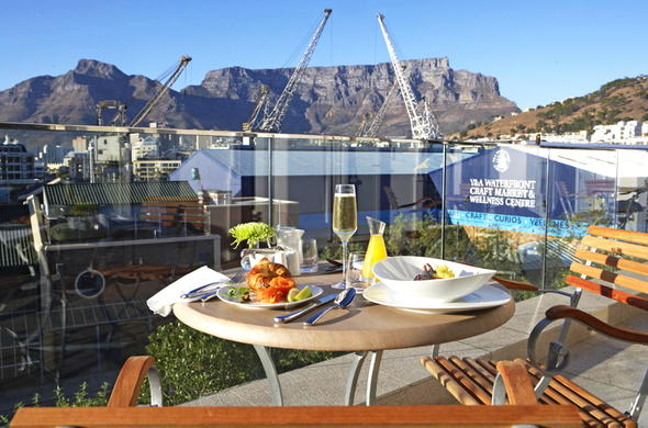 Dine on the balcony with a view of table mountain.